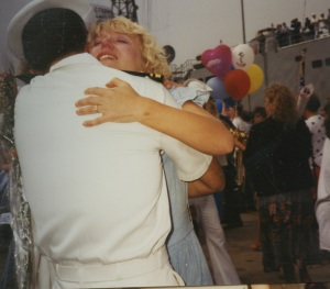 Leah giving me an emotional welcome home hug after my ship's Gulf War deployment.