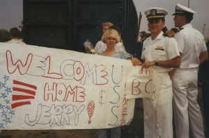 Leah and I holding the sign she, Jenn, and Mom made for our arrival home. Dad was onboard too for the last leg of the trip.