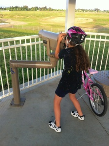 Gigi trying to spot one of the migrating birds on our bike ride...