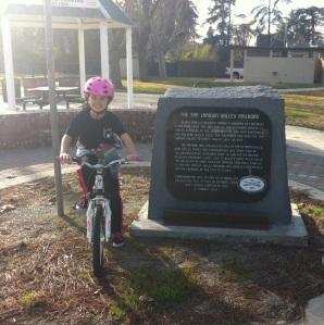 Gigi next to the Railway Bike Trail Marker near Old Town Clovis