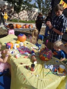 Kids painting pumpkins at the Clovis Hills Pumpkin Party