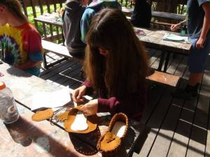 Gigi working on moccasins at the Craft Shack