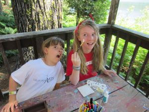 Elowyn and Gigi goofing off during a craft shack project