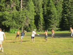 Playing Ultimate in the field next to Camp Gaines