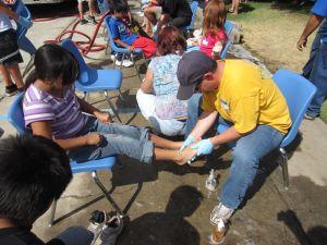 Jason washing a child's feet during Faithful Feet at El Encino Baptist Church