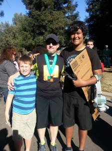 Jason poses with medal after finishing 1:2 marathon with Zach and Markus