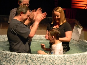 Jason and Stacy baptizing Zach at Clovis Hills