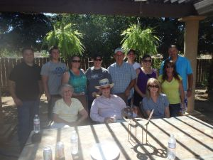 Families from Jason's Growth Group at a BBQ at the Holsteins. Phil Dodd seated in front of Jason.