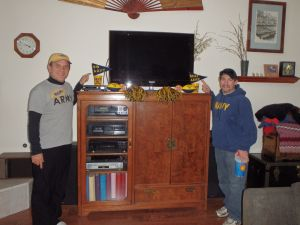 Jerry and Jason rooting for perennial winner Navy during the Army-Navy Football game in 2013