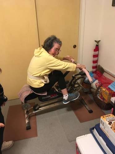 Mom on Exercise Cycle