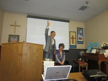 Pastor Hajimu Fujii officiates mom's baptism